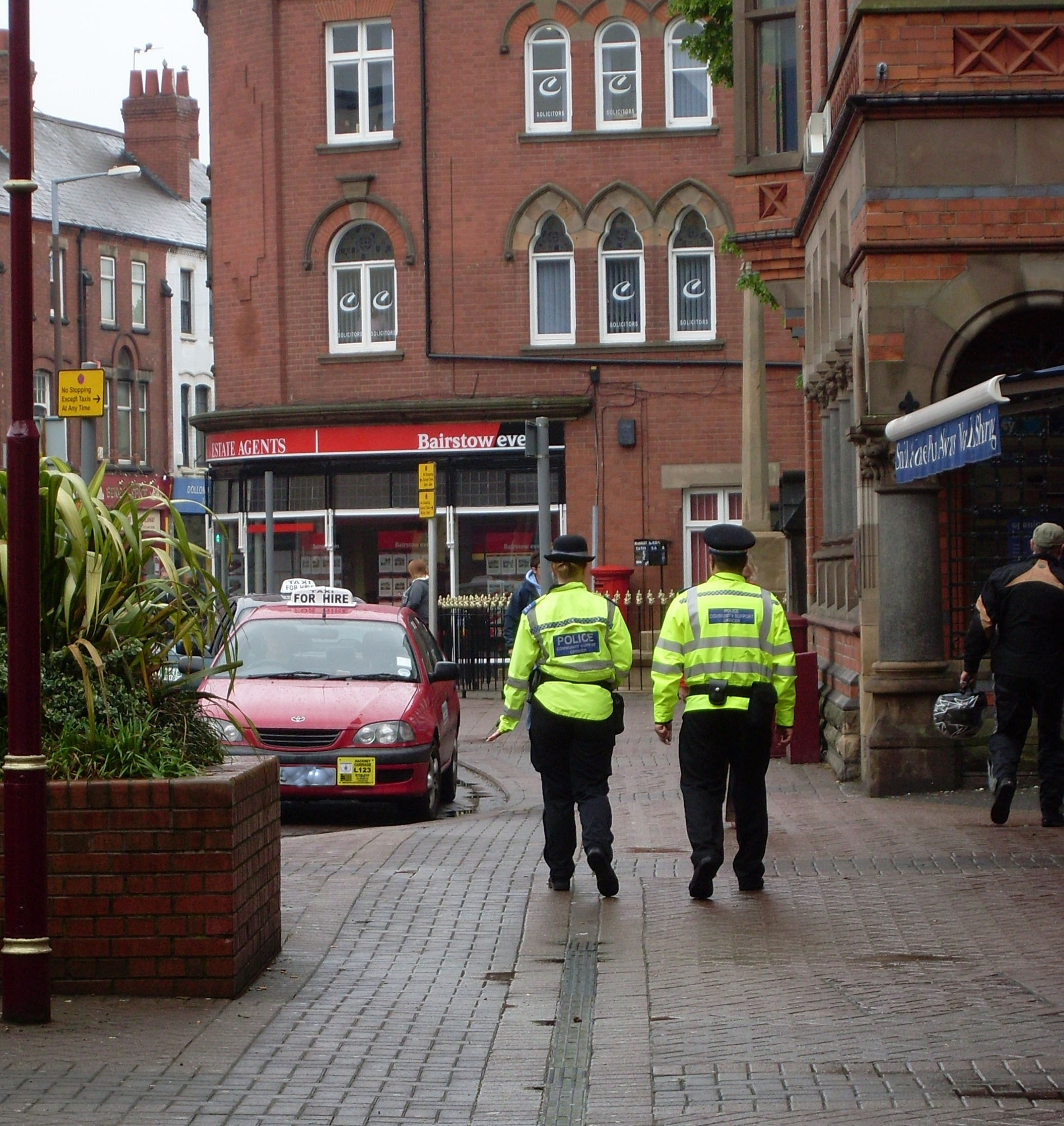 Two police officers walking down Long Eaton High Street